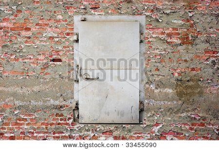 security door on brick wall