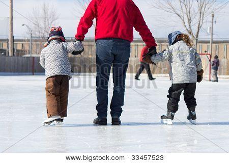 Family Having Fun At The Skating Rink