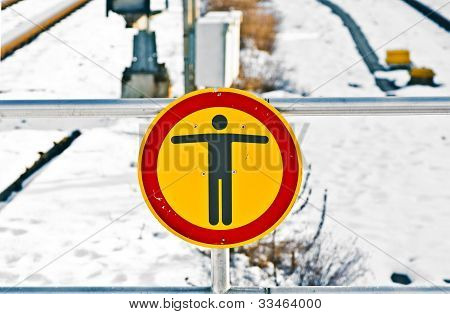 No Trespassing Sign At Rails In Winter