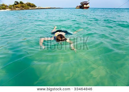 Young Boy Enjoys The Ocean