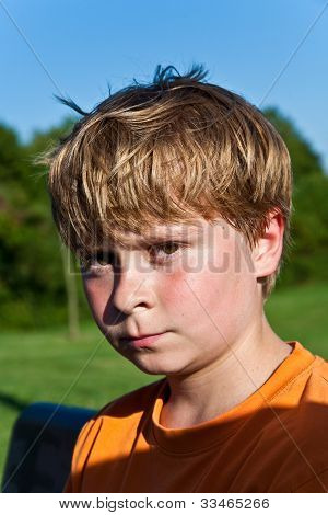 Portrait Of Sweating Boy After Sports