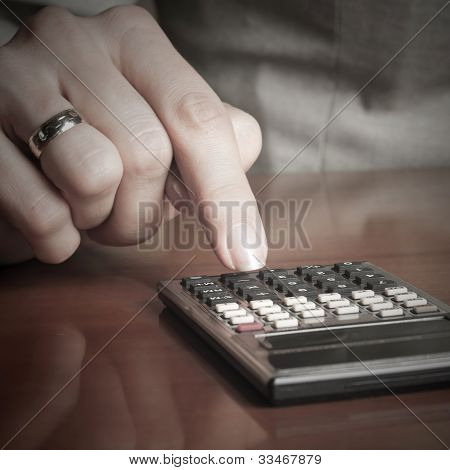 Business Woman Typing On Calculator