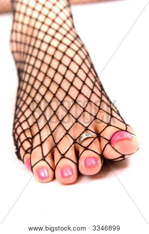 Painted Toes In Fishnet Stockings