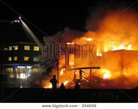 Firefighter Fighting Burning House