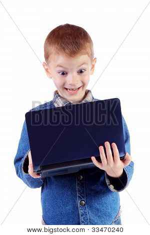 Red Little Boy With Surprise Looks In The Laptop