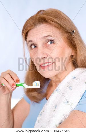 happy old woman brushing