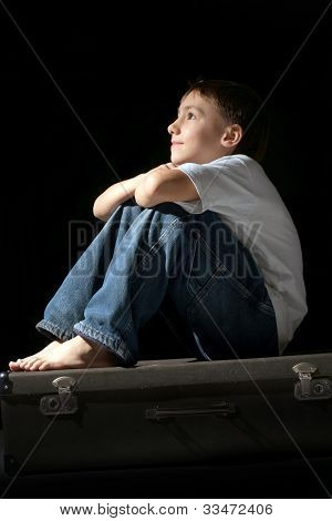 Beautiful Caucasian Nice Boy Sitting On A Suitcase
