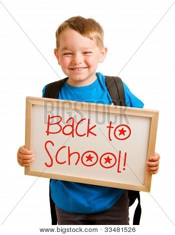 "Education concept with child holding sign that reads ""back to school"""