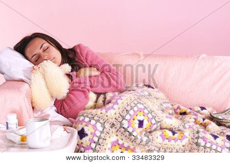 Girl In Bed With Toy