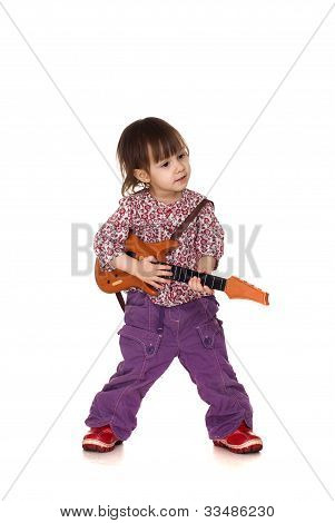 Beautiful Good Little Caucasian Girl Plays With A Guitar