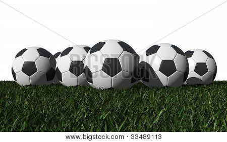 Soccer Balls On A Green Grass