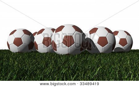 Brown Soccer Balls On A Green Grass