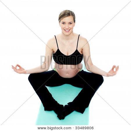 Beautiful Pregnant Woman In Lotus Pose