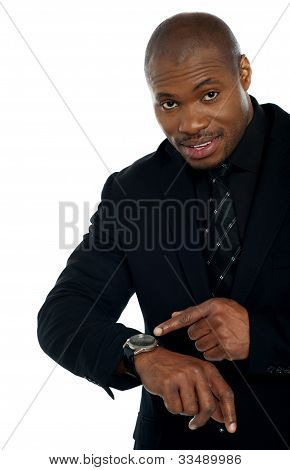 African Male Indicating Towards Wrist Watch