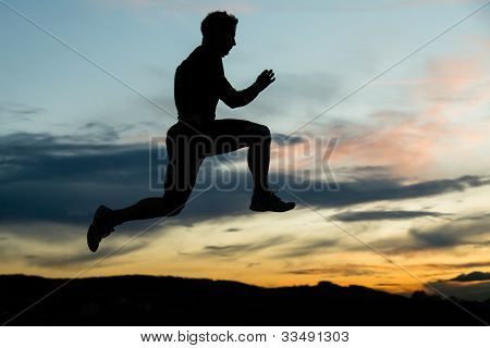silhouette of a jogger