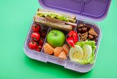 Lilac Lunch Box With Useful Food For Lunch And Snack: Sandwich, Vegetables, Fruits, Nuts And Eggs On poster