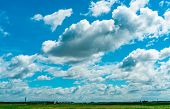 Landscape Green Grass Field And Wire Fence Of The Airport And Beautiful Blue Sky And White Fluffy Cl poster