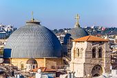 The roofs of Jerusalem. Domes of the Temple of the Holy Sepulcher. Golden crosses sparkle in the sun poster