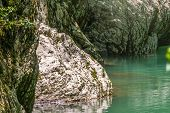 Transparent Clear Mountain River In A Stone Gorge. Mountain River With Clear Turquoise Water. poster