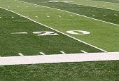 picture of football field  - 20 yard line markings on an artificial turf football field - JPG
