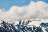 Atmospheric Alpine Landscape To Snowy Mountain Ridge In Sunny Day. Snow Shines In Day Light On Mount poster