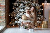 Family Celebrates Christmas. Happy Mother With Daughter In Magic Night. Gifts, Christmas Tree With Y poster