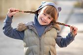 Portrait Of Happy Child Girl With Hair Braids In Warm Clothes In Autumn Outdoors. poster