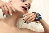 Multi-colored Fashionable Makeup And Manicure In Turquoise Golden Blue And Brown Tones.nail Art With poster