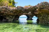 landscape with rocks in ocean on Zanzibar ocean shore poster