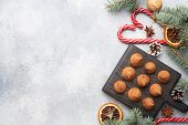 Delicious Chocolate Truffles Sprinkled With Cocoa Powder On A Wooden Stand. Christmas Tree Scenery C poster