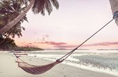Tropical paradise beach with palm trees and traditional braided hammock poster