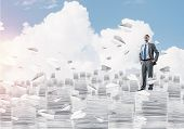 Confident Businessman In Suit Standing Among Flying Paper Planes And Looking Away With Cloudly Skysc poster