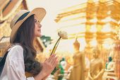 Woman Traveler Tourist Praying At Buddhist Temple. Journey Trip Travel Concept poster