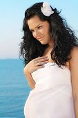 Beautiful  Pregnant Woman On Sky Background, Outdoors