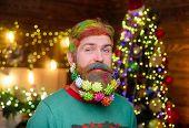 Decorated Beard. Christmas Holidays. Christmas Decoration. Happy Santa Man With Decorated Beard. Chr poster