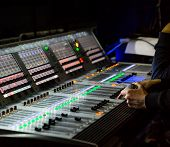 Sound Engineer Controls The Settings Of Mixing Console poster