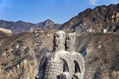 The Great Wall Of China In Winter. Sculptures Of Ancient Warriors On The Background Of The Great Wal poster