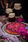 Fresh Homemade Upside-down Plum Cake On Rustic Background poster
