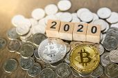 2020, Business, Money And Cryptocurrency Concept. Close Up Of Silver And Gold Bitcoin On Pile Of Sil poster