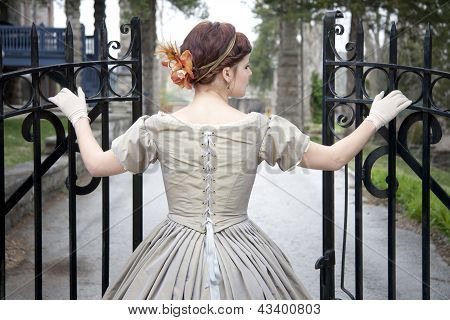 Beautiful Woman Opening Gate