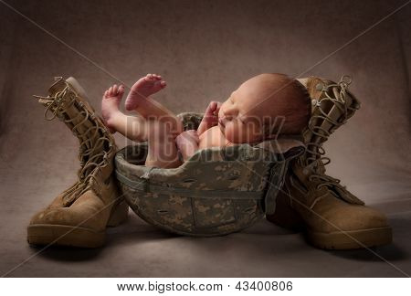 Newborn Baby in Helmet