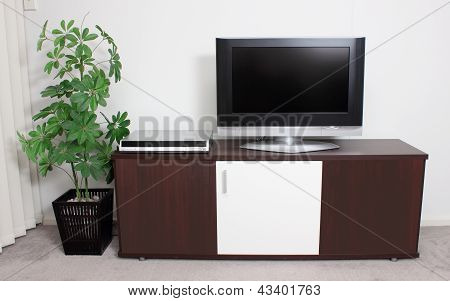 TV on Wooden Cabinet