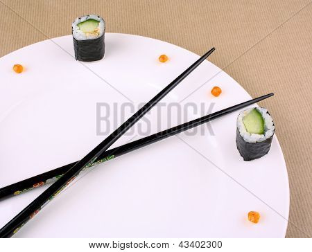 Sushi Time Concept With Caviar On White Plate