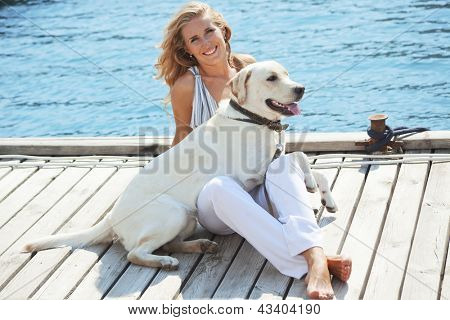 Portrait of young girl with her dog