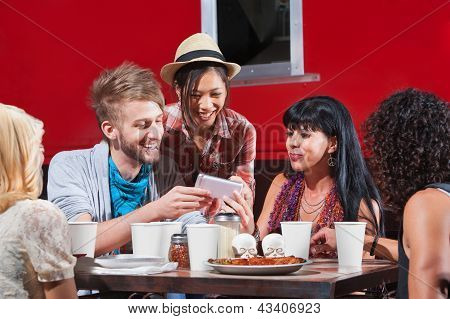 Diverse Group Eating And Texting