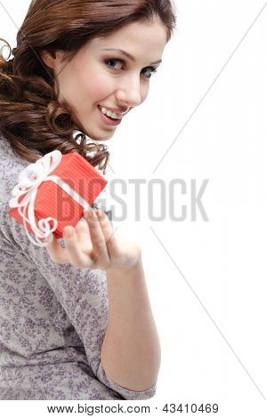 Pretty woman hands a gift wrapped in red paper, isolated on white