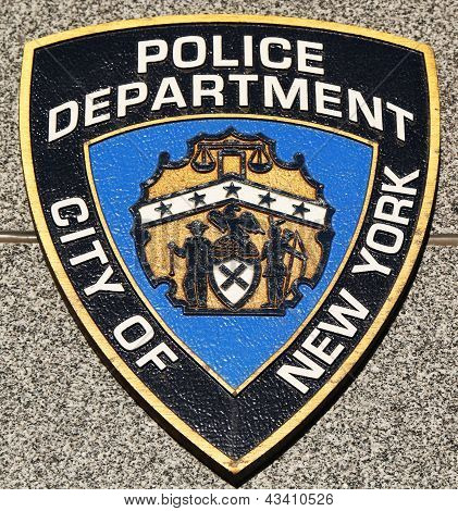 NYPD emblem on fallen officers memorial in Brooklyn, NY.