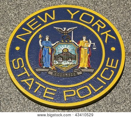 New State Police emblem on fallen officers memorial in Brooklyn, NY.