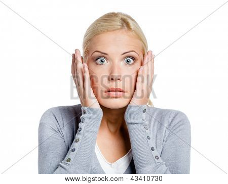 Shocked woman puts hands on her head, isolated on white