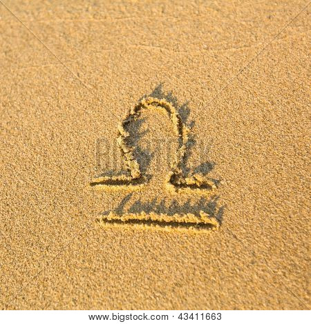 Zodiac sign Libra, drawn on the facture beach sand. (zodiac signs series)